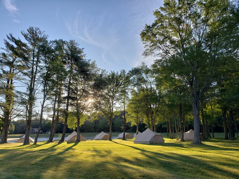 Terra Glamping Events tents near pond