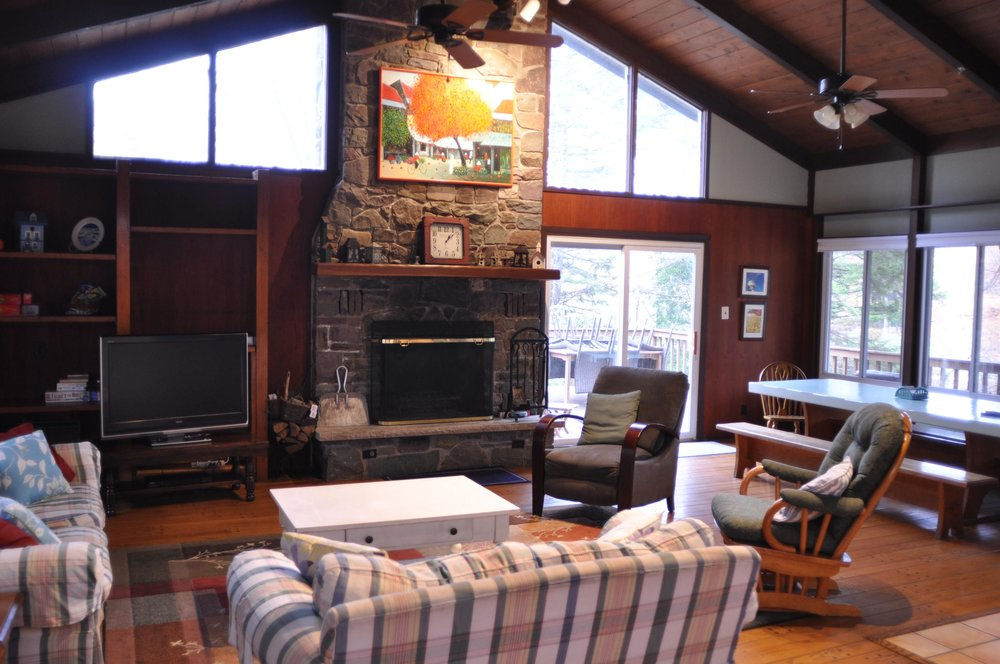 Lots of Seating, TV, and Wood Burning Fireplace.