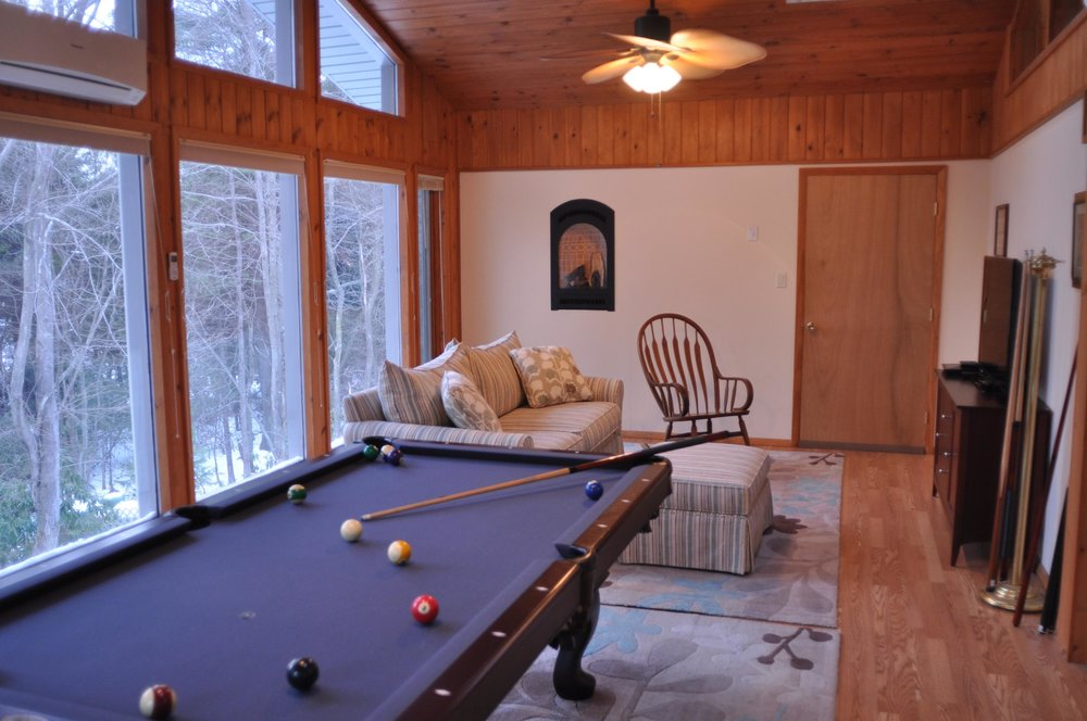 Game Room Upstairs with Pool Table and TV.