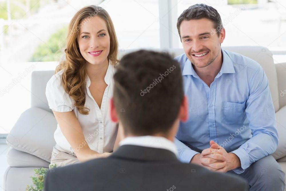 depositphotos_39197321-stock-photo-smiling-couple-in-meeting-with.jpg