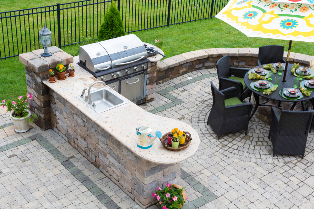 Outdoor kitchen with dining set