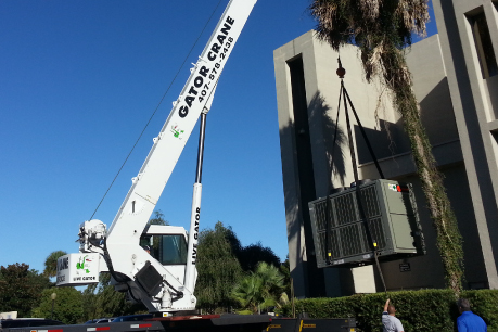 HVAC Unit being lifted on commercial builidng