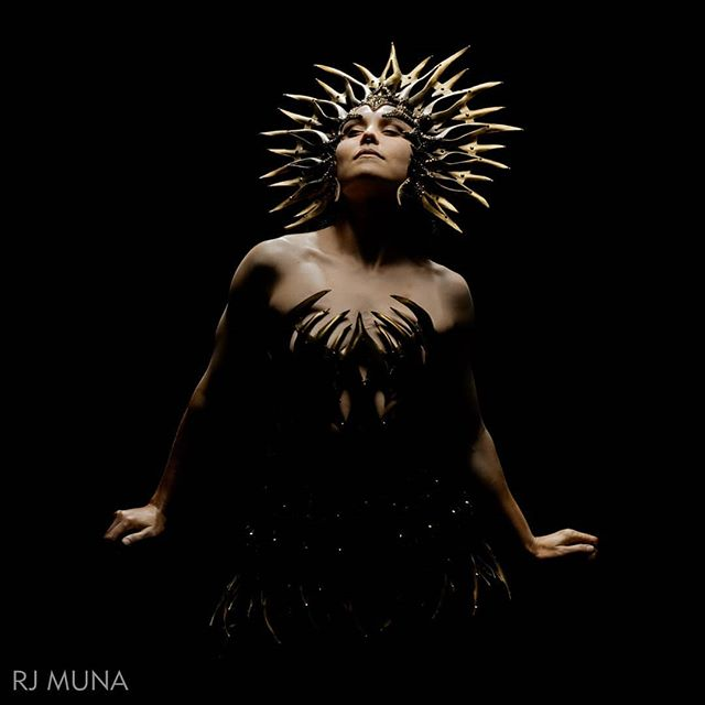 A ray of dark studded light in all this darkness. The Black Star Goddess hand cut and sculpted leather headdress by #Lyraphic  Photo by TO MUNA  One of a kind work available now courtesy of @fiveanddiamond  #darkfashion #darkbeauty #TheBlackStarGoddess #wearableart #fantasyfashion #leather #couture #cosplayfashion #comiccon #Lyraphicbeauty