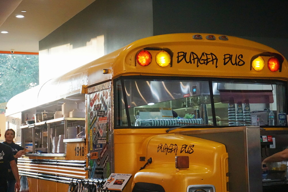 The original bus where it all started is now the kitchen at the Heights location
