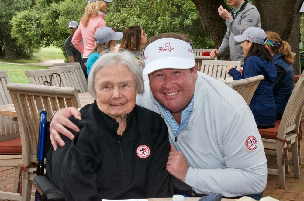 Leonore Daschbach and Doyle Rundell at The Howard Daschbach Memorial Golf Tournament