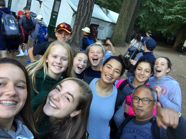 The 8th graders and their chaperones are all smiles as they begin their adventure.