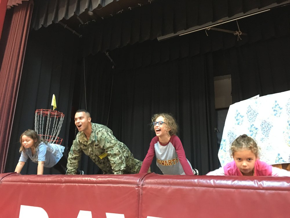 Lieutenant Colorado and his daughters lead the school in push-ups!