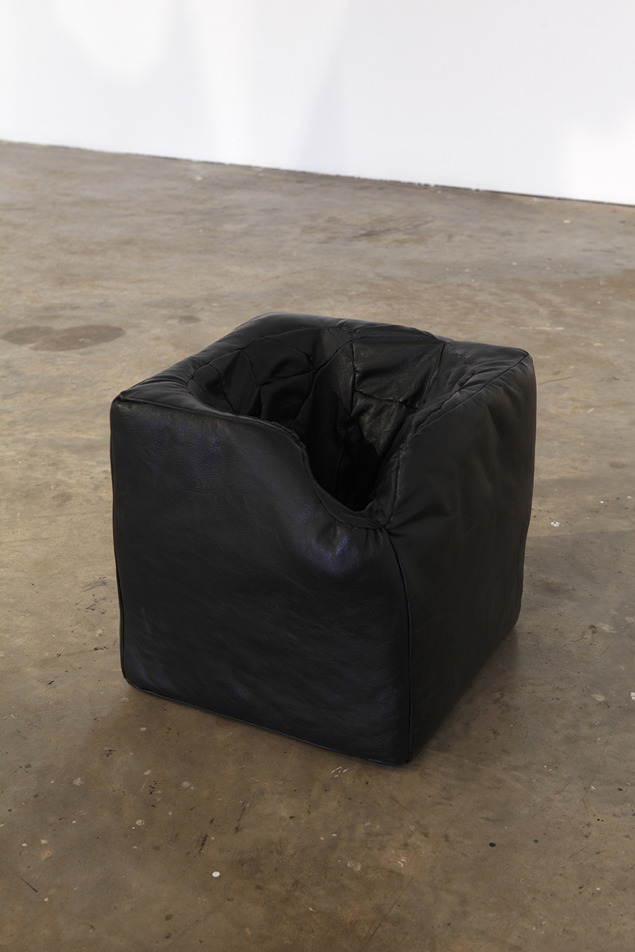 Talitha Kennedy,  Domestic Black Hole  2013. Leather, thread and polyester fibre. 30 x 30 x 30cm. Photograph Fiona Morrison.