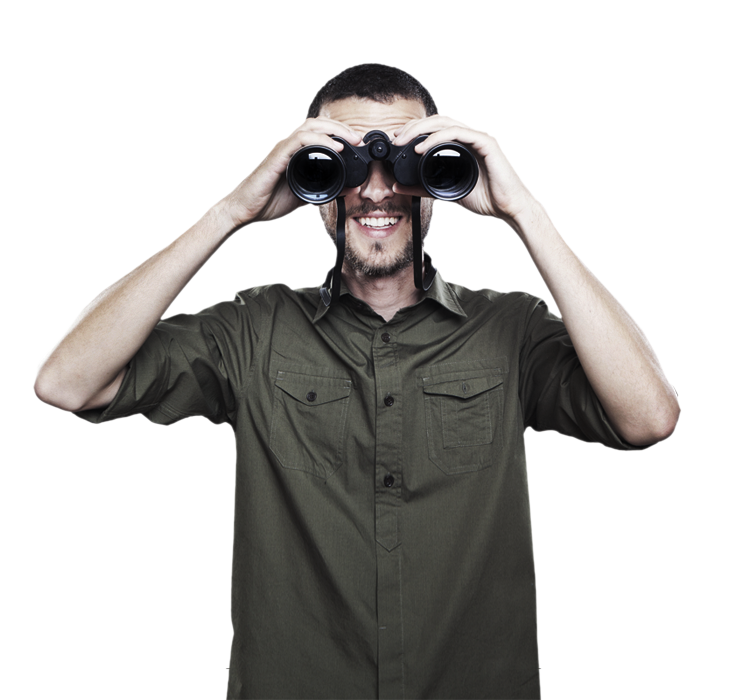 man in green shirt looking through binoculars