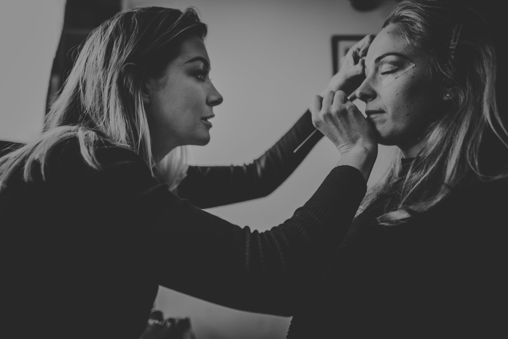 Hannah Applying Eye Makeup During a Wedding Trial