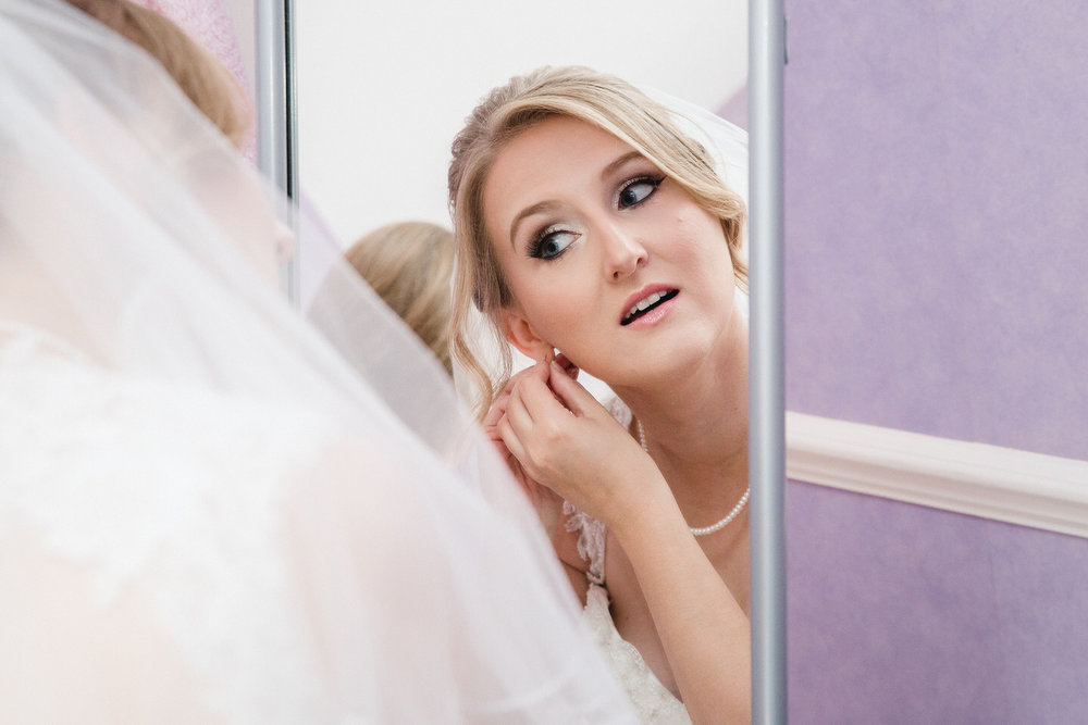 Wedding makeup being looked at by bride whilst getting ready