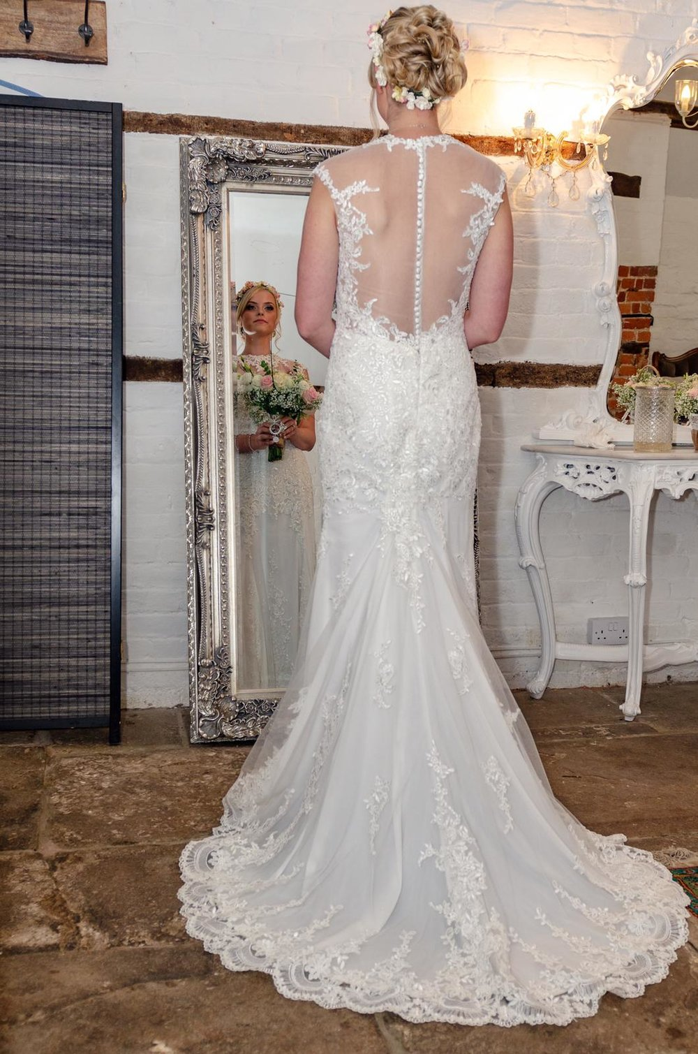 Fit and flare wedding dress with detailed lace back