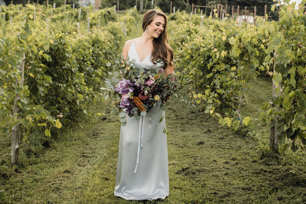 Stunning Simple, Delicate and Romantic Vene AI custom gown accompanied by Jennifer Joyce dynamic floral bouquet.