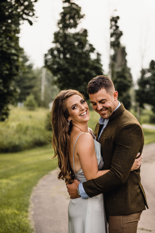 Vene AI custom wedding gown. Ashley and Nick are all smiles!