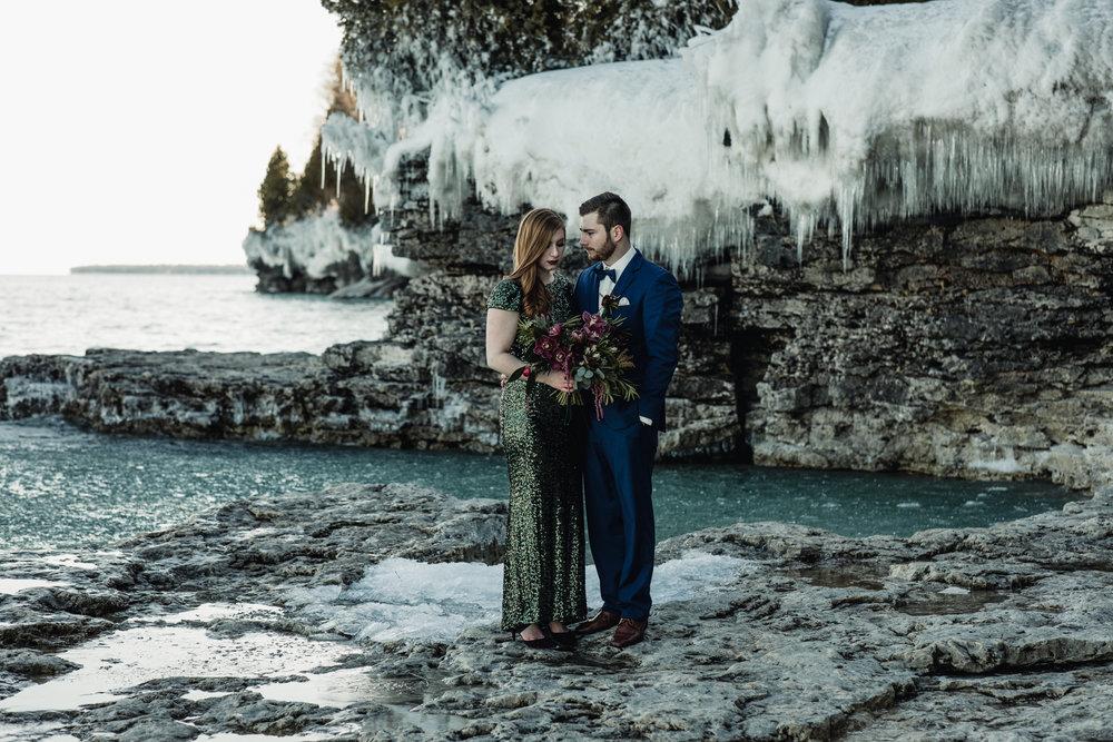 Cave Point Elopement - Florals:Ebb & Flow || Suit: Zegers Clothiers || Makeup: Jillian Dawson || Settings: Moonlight Party Rentals || Tables: Vintage Farmhouse Tables