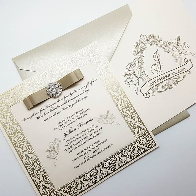 A little #angel is getting baptized soon! Here's the gorgeous #invitation we created for him, featuring brushed gold foil stamped border, vellum, a satin bow with rhinestone gem, and a custom monogram.
