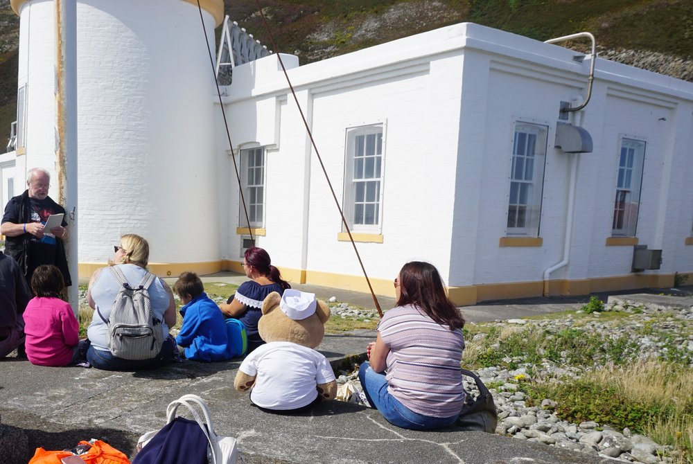 Enjoying stories with Malcolm, former Lighthouse Keeper of Ailsa Craig