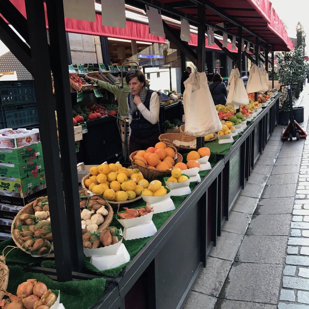 Street market in Paris rue Clerc