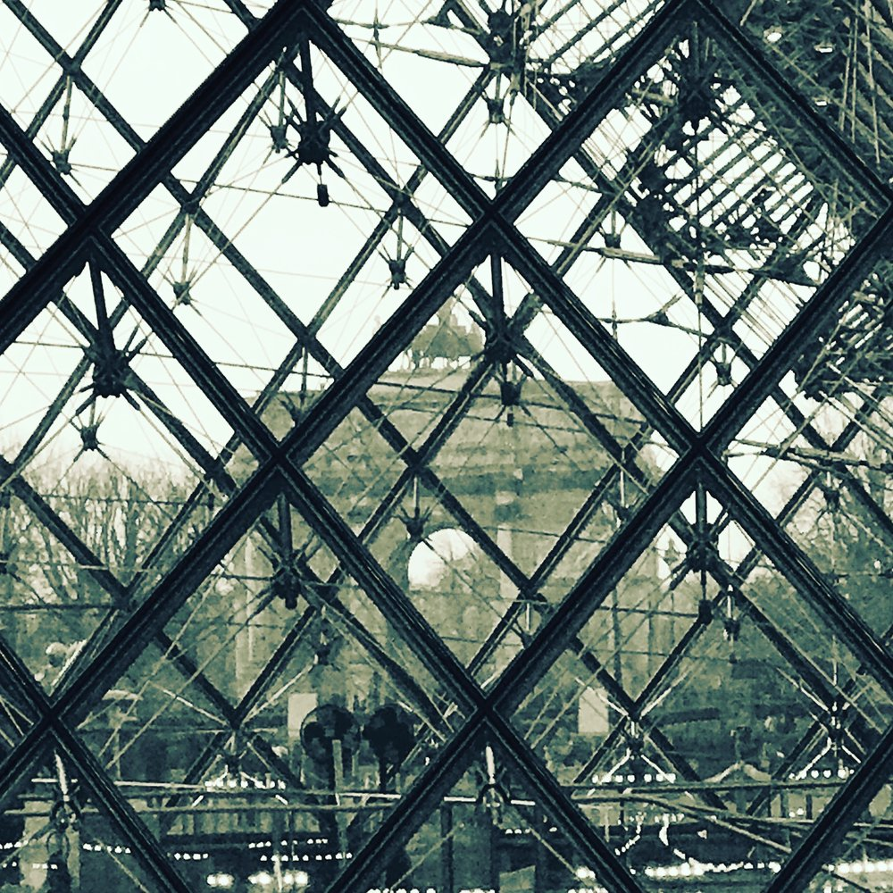 Through The Pei Pyramid (du Louvres) in Paris and we can see Le Petit Carousel!