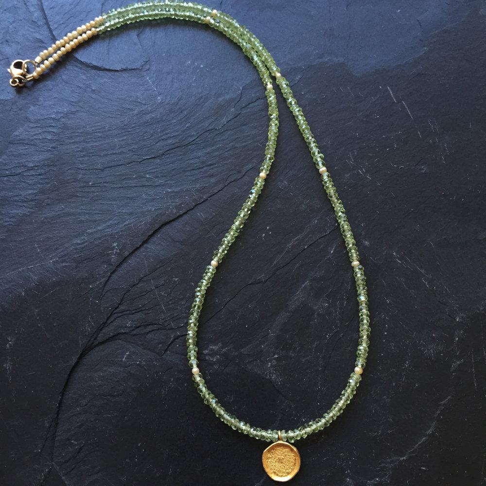 green peridot gold round full.JPG