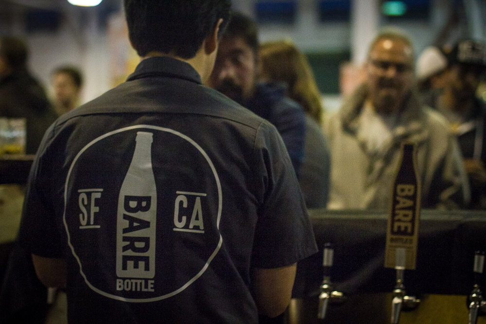Lester Koga pouring beers at the SF Beer Week Opening Gala 2017