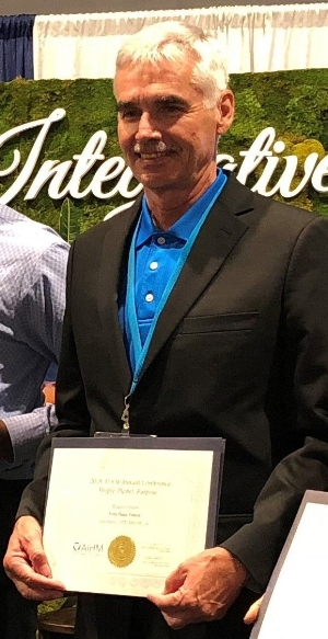 Dr. John Burns awarded first place of the AIHM 2018 posters. photo credit Megan Gale