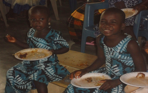 Two Tsito village girls enjoying a special Christmas meal