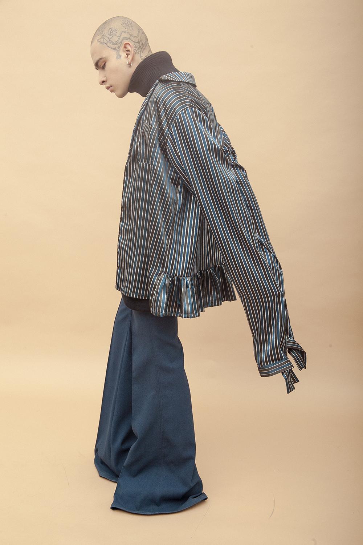 Él:Camisa y cuello alto - Mancandy |Pantalón - Alfredo Martínez