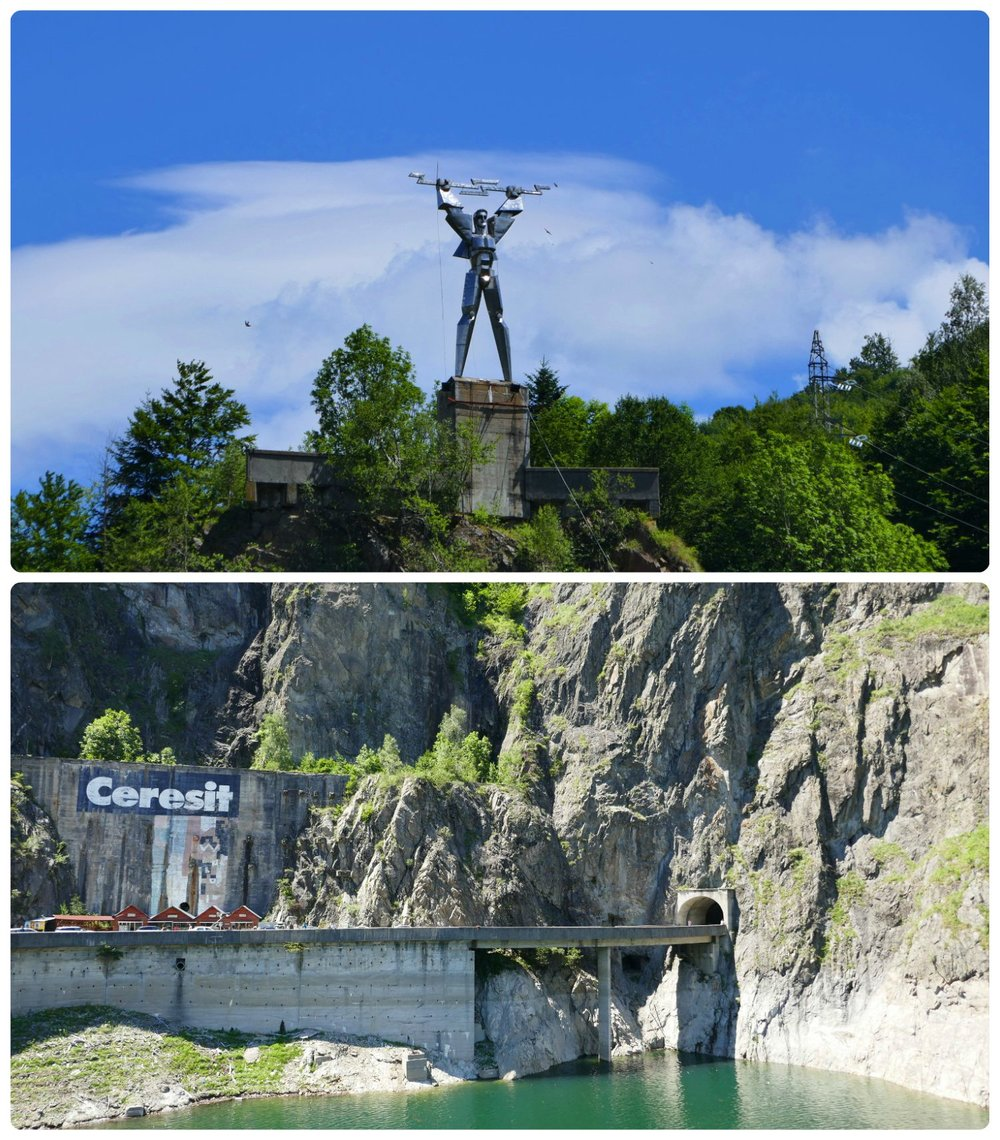 Top : We didn't spot it at first, but at the far side of Vidraru Dam on the top of Plesa Mountain is a sculpture of Prometheus holding a lightening bolt.  Bottom : Make a left turn as soon as you pass through the tunnel and reach Vidraru Dam to find a place to park or to take the longer route around the lake. (Note, the tunnel above is reached after the turn and is the start of the route along the lake.)