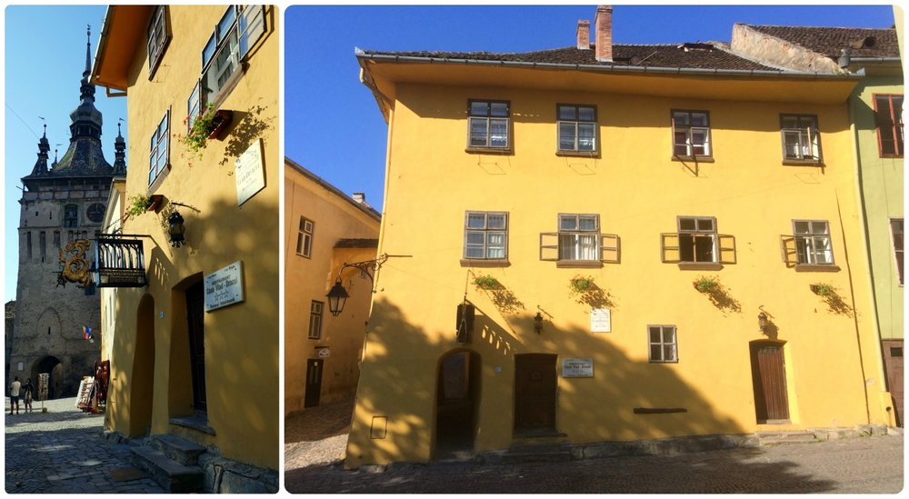 Vlad Dracula House is simple to find. Make your way to the Clock Tower (shown on the left) which can be seen from just about anywhere in Sighisoara. Then spot the yellow three-story building with a golden dragon hung over the doorway.