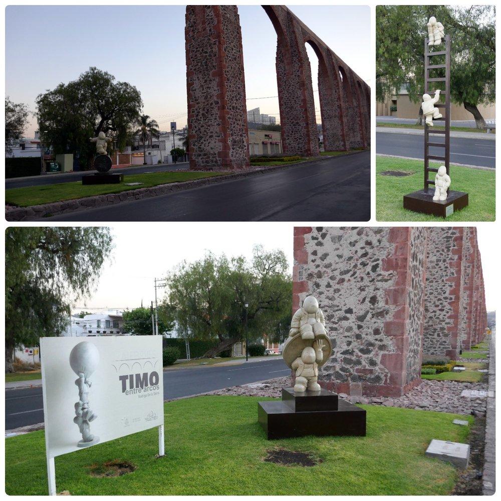 During our visit there was an art exhibition on display at the arches.  Timo entro Arcos  by  Rodrigo De la Sierra . Top right image is of  Big Steps . Bottom image is of  Los de Arriba y Los de Abajo.