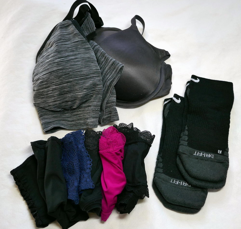 I pack 4-5 days worth of socks (2-3 pairs) and underwear (4-5). I pack a bra and a sports bra, alternating and hand washing when needed.