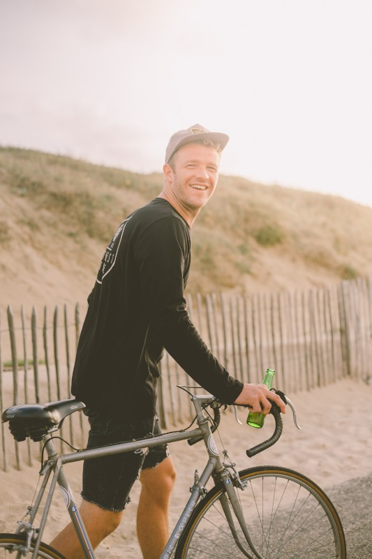 Happy guy with bike and beer