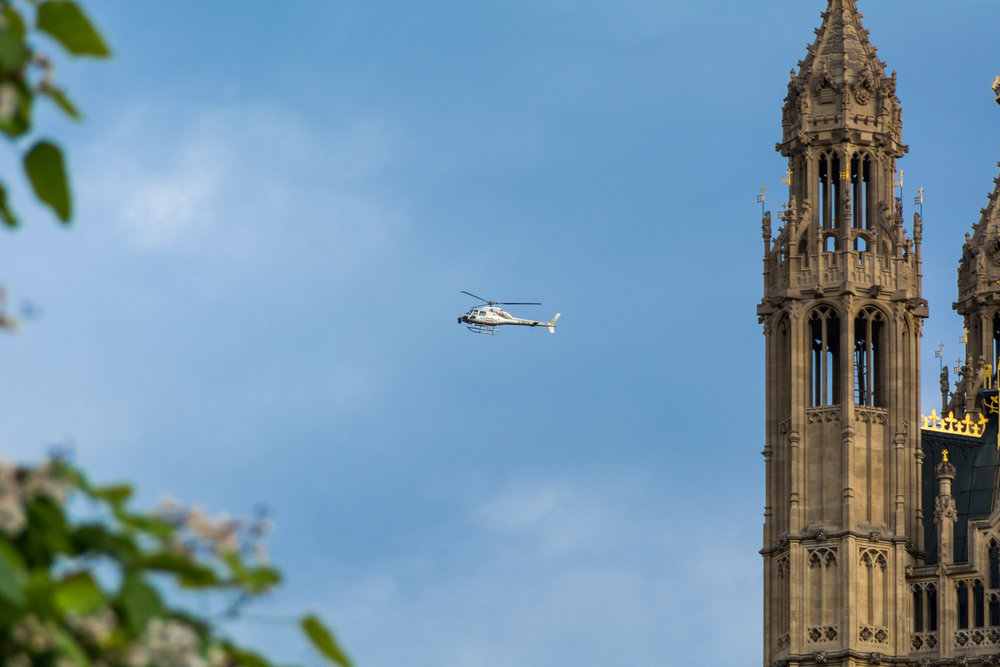A Sky News helicopter circles above Parliament