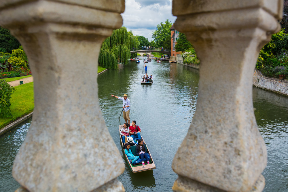 Tourists punting down the River Cam