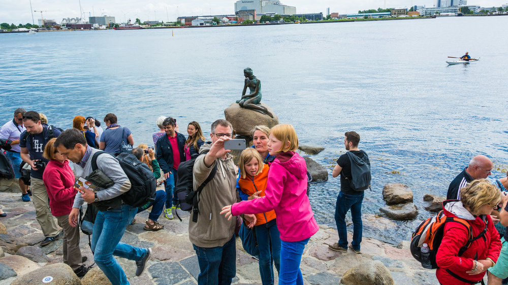 Tourists flock to the infamous Little Mermaid statue in Copenhagen