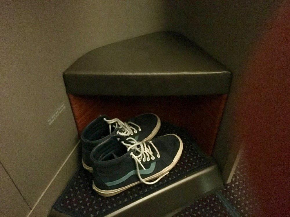 There's a convenient cubby for shoes under the ottoman.