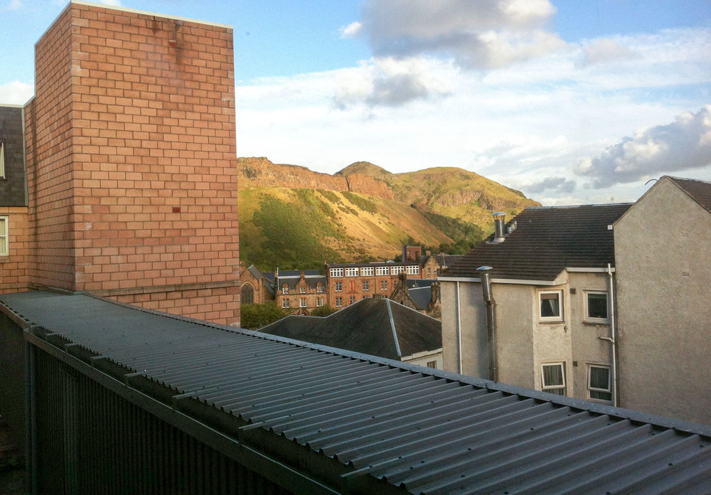 A glimpse of Arthur's Seat through the window of my first flat.