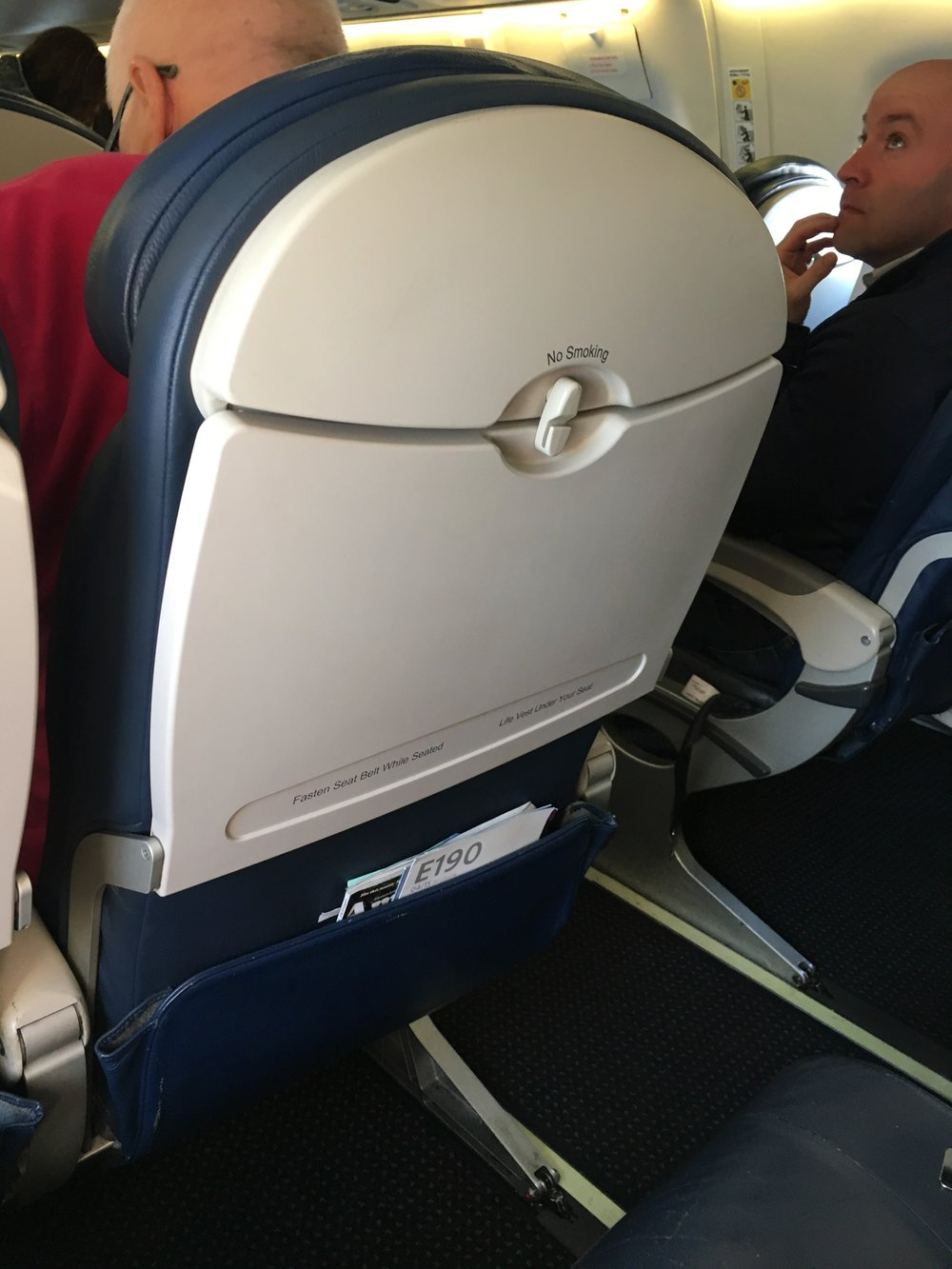 Blue seats, big tray table