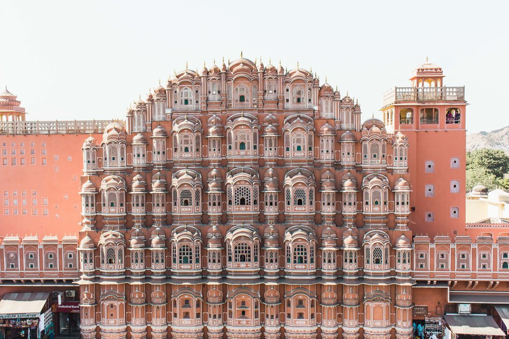 "The Hawa Mahal - aka the Palace of Winds - completed in 1799 is constructed on red and pink sandstone. The original function of the lattice was so that the royal ladies could look out over the street without being seen, as they had to obey ""purdah"" (face cover). (Wikipedia is full of good information)."