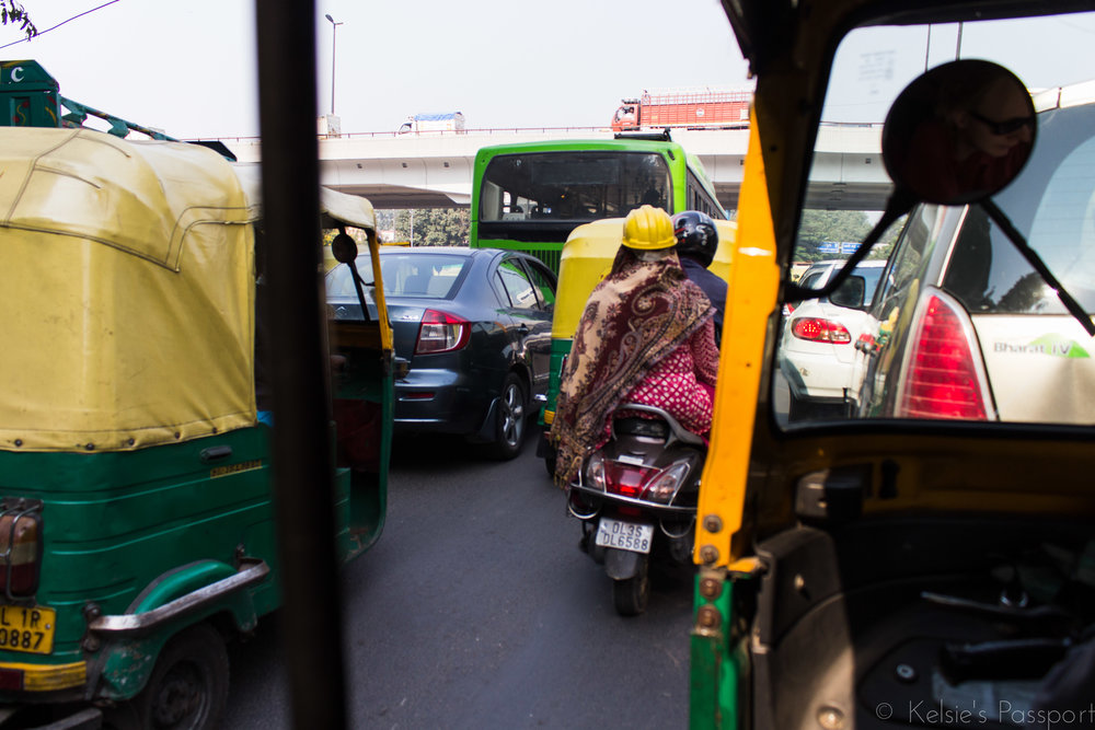 There's a few cars in India and a few (all) of them are honking.
