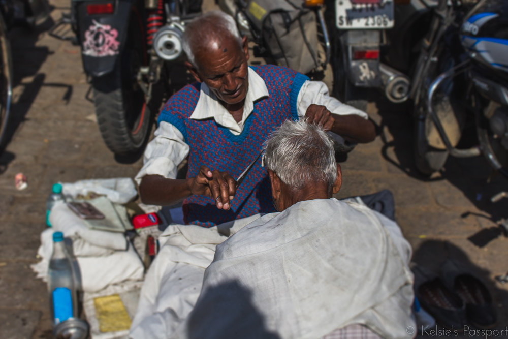 A shave and a haircut on the streets of Jaipur.
