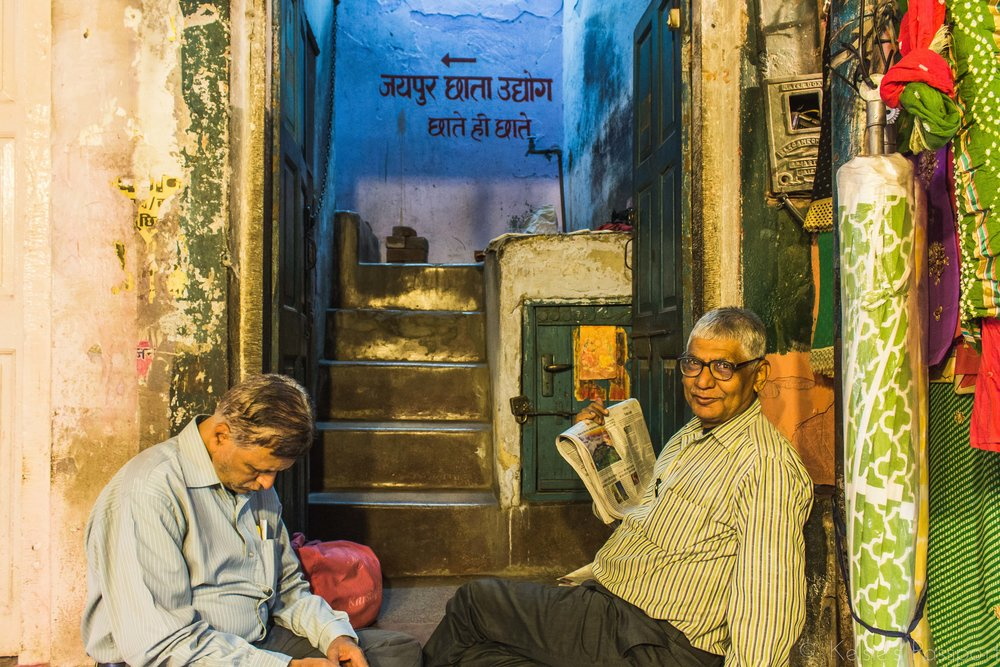 Two men pass the time on a side street in Jaipur.