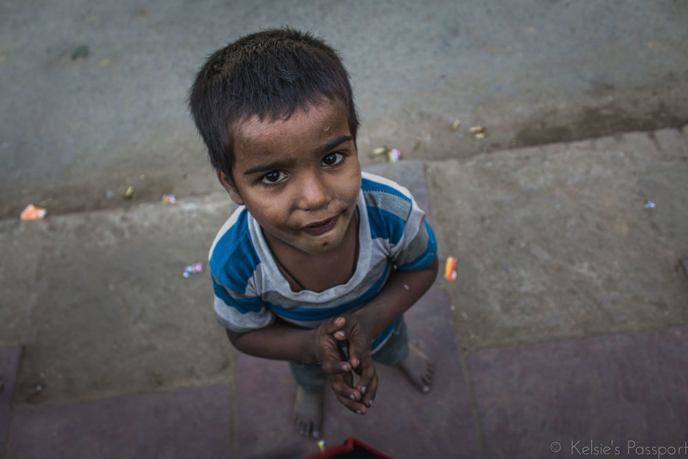 A boy asking for money.