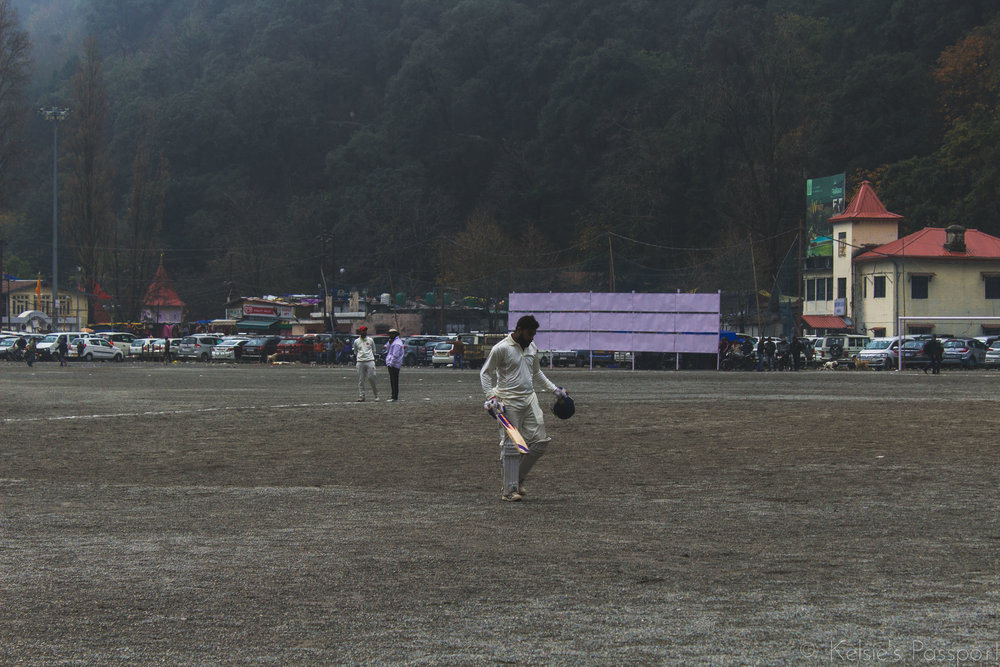 A game of cricket on the high cloudy mountains in Nainital.