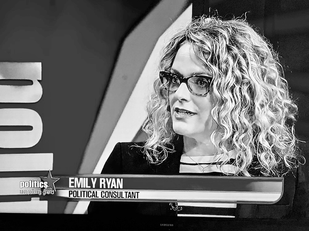 Emily Ryan explaining Arizona politics to viewers
