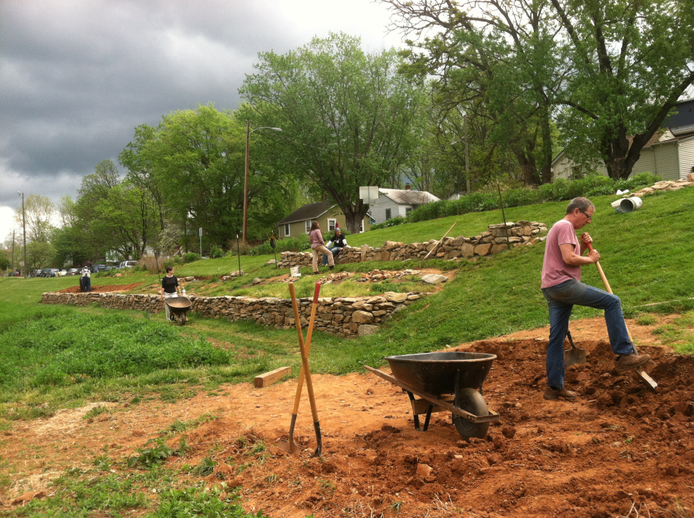 Volunteers backfill terraces and build walls during a Saturday morning volunteer day.