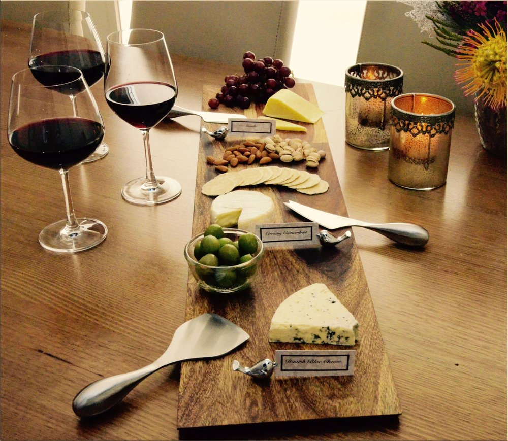 Cheese board and wine glasses