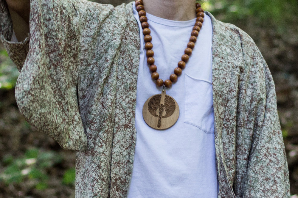 Wooden Necklace   Inspired by black power necklaces, I set out to make my own with the symbols that empower me.
