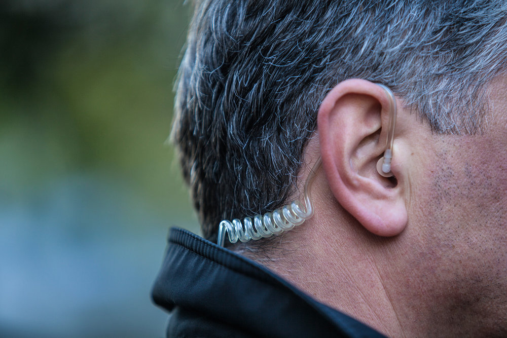 man wearing earpiece